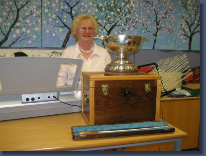 Elizabeth with the mixed choirs trophy and the baton